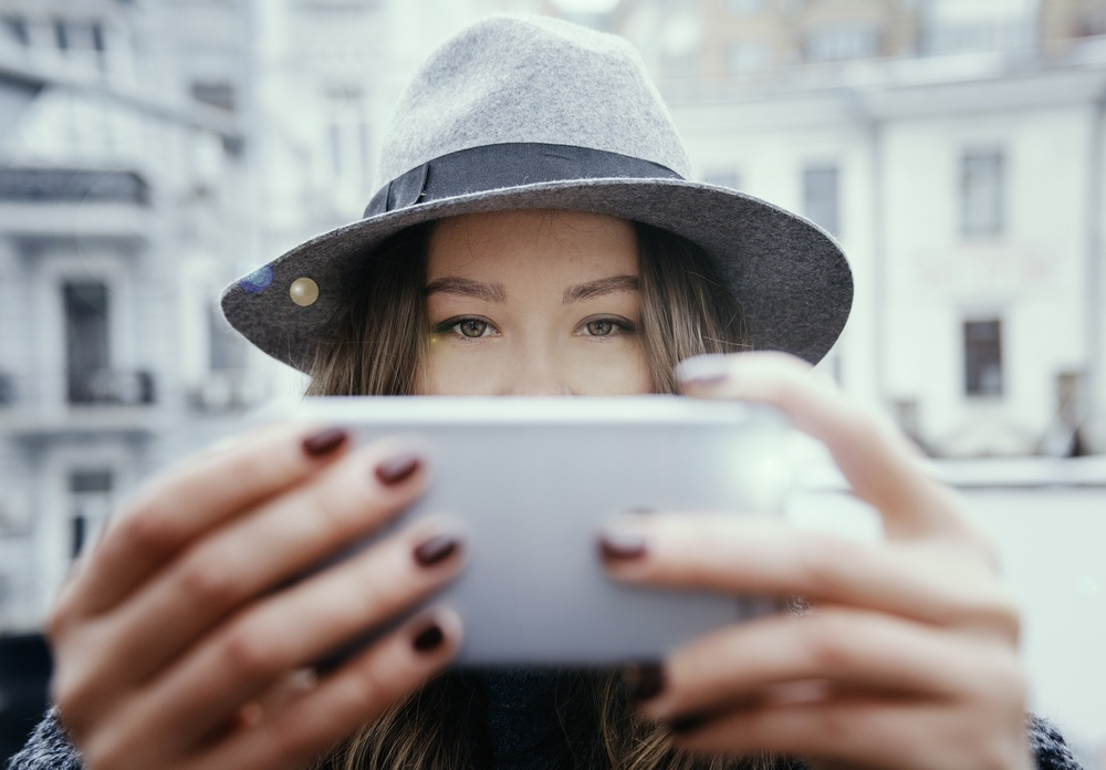 young woman using camera phone